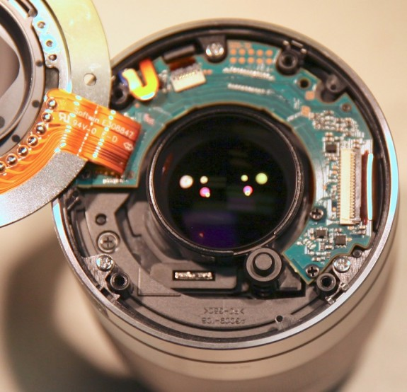 Sony 50mm f/1.8. The 4 hollow plastic posts are where the screws from the lens mount attach.